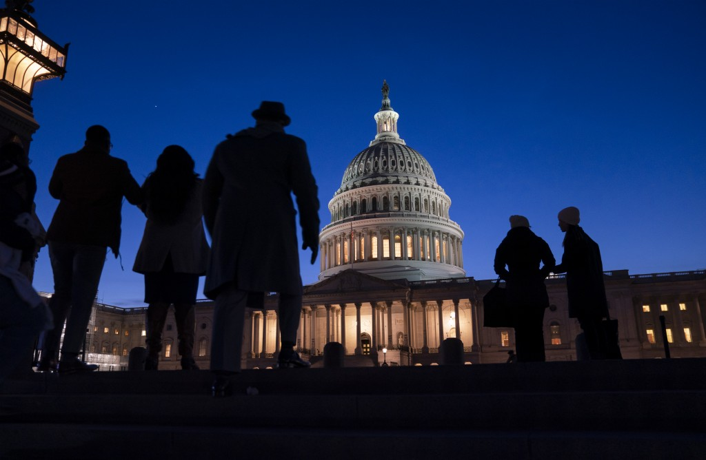 Night falls on the Capitol, in Washington, Wednesday evening, Jan. 22, 2020, during in the impeachment trial of President Donald Trump. House prosecut...