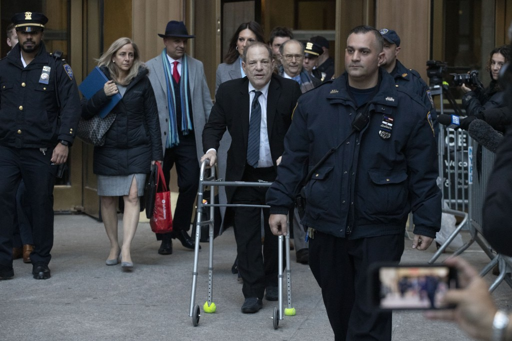 Harvey Weinstein, center, leaves a Manhattan courthouse following a day in his trial on rape and sexual assault charges, Wednesday, Jan. 22, 2020 in N...