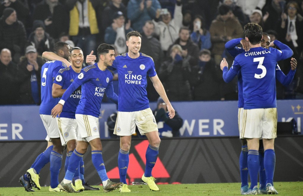 Leicester players celebrate after Leicester's Ayoze Perez scored his side's fourth goal during the English Premier League soccer match between Leicest...