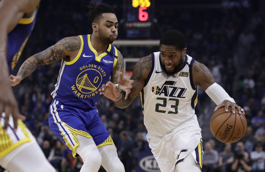 Utah Jazz forward Royce O'Neale, right, drives the ball against Golden State Warriors' D'Angelo Russell (0) in the first half of an NBA basketball gam...