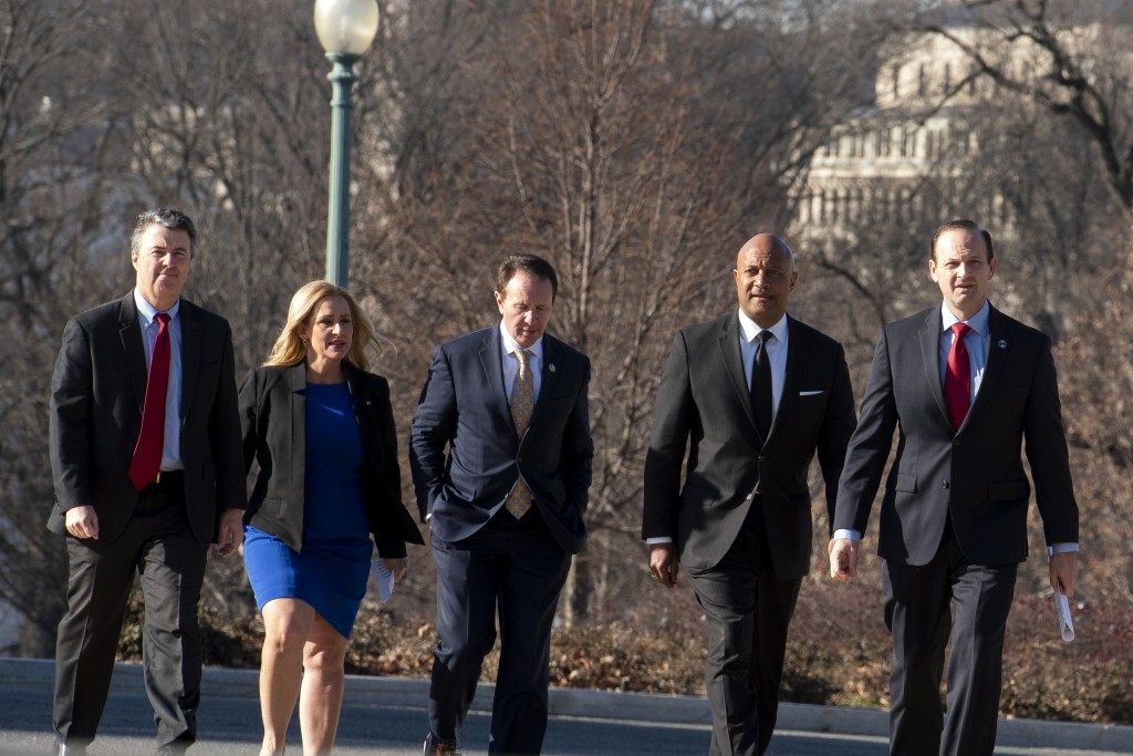 States Attorneys General, from left; Steve Marshall, Ala., Leslie Rutledge, Ark., Jeff Landry, La., Curtis Hill, Ind., and Alan Wilson, S.C., walk to ...