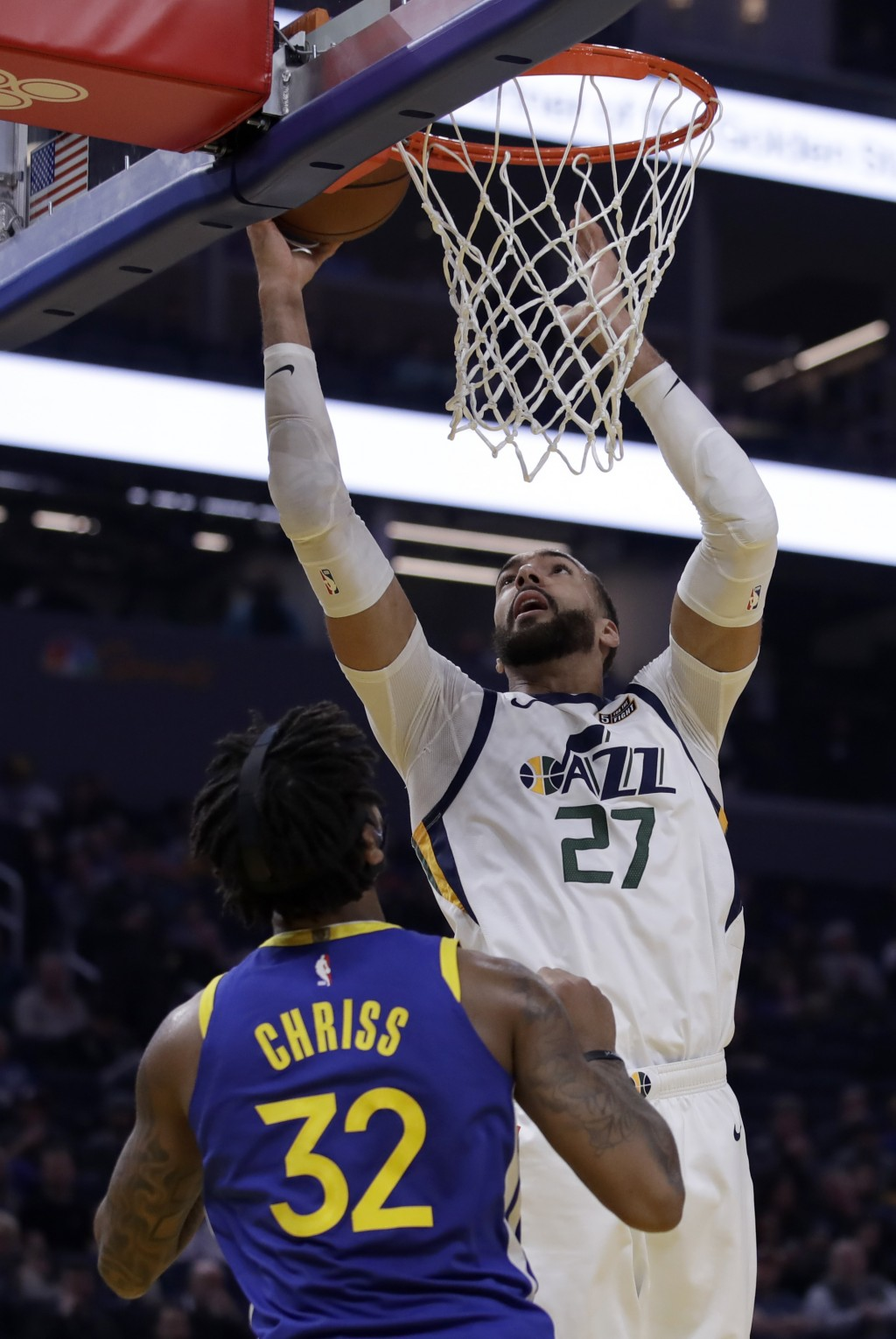 Utah Jazz center Rudy Gobert, right, shoots over Golden State Warriors' Marquese Chriss (32) in the first half of an NBA basketball game Wednesday, Ja...