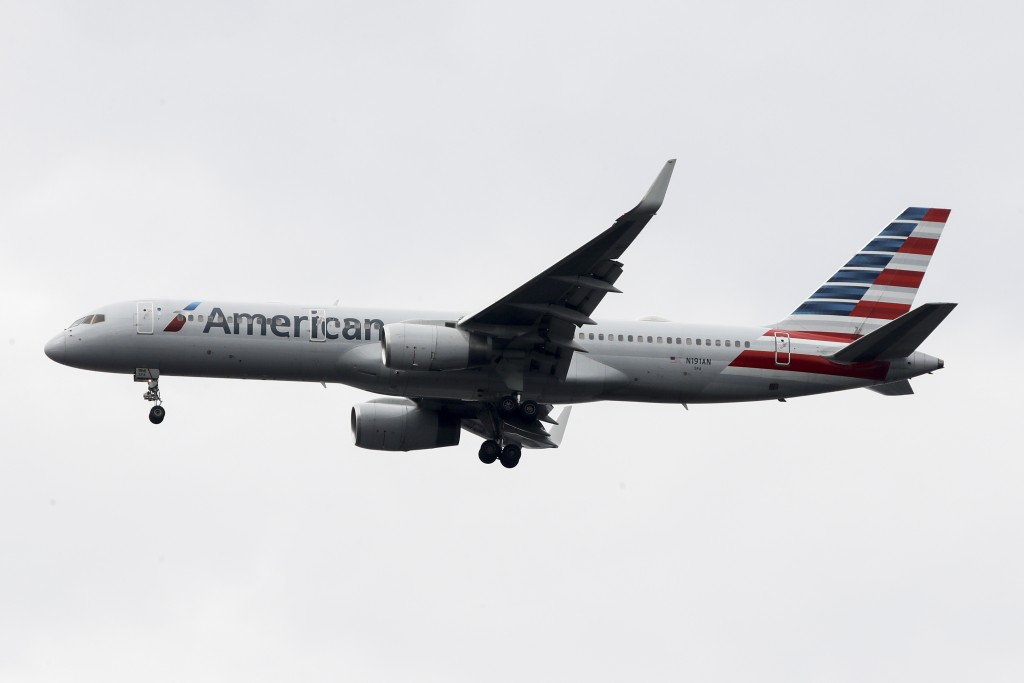 FILE - In this Nov. 7, 2019, file photo an American Airlines jet approaches Philadelphia International Airport in Philadelphia. American Airlines repo...