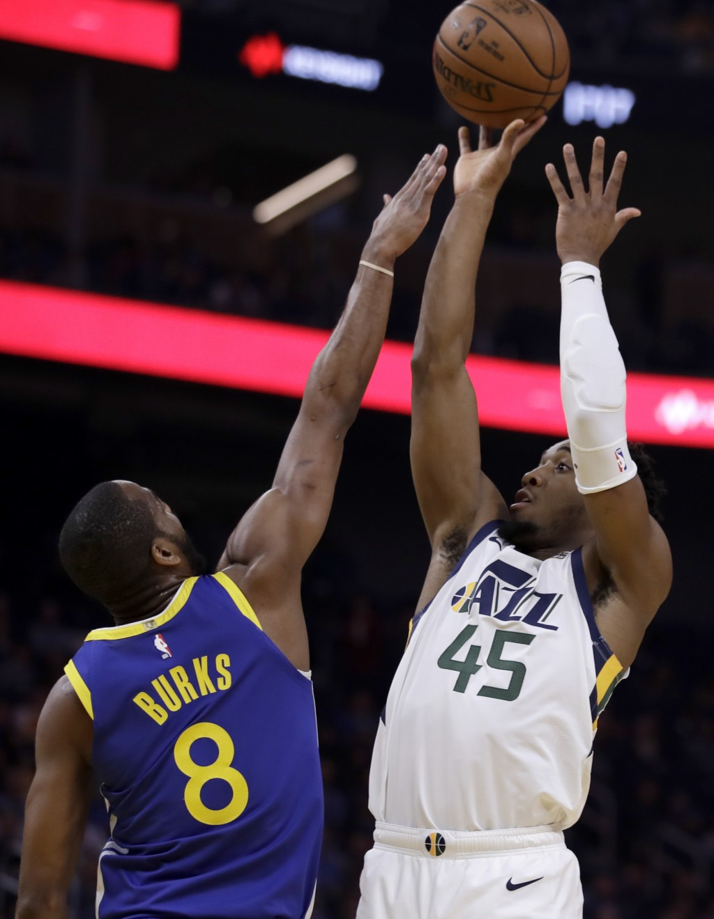 Utah Jazz guard Donovan Mitchell, right, shoots over Golden State Warriors' Alec Burks (8) in the first half of an NBA basketball game Wednesday, Jan....