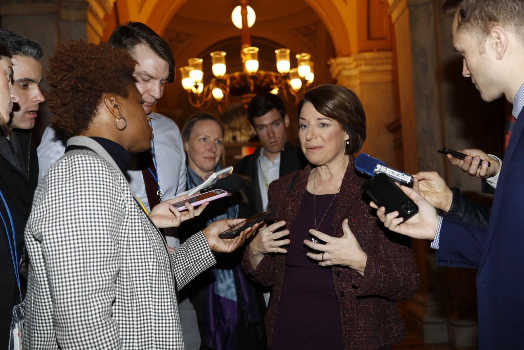 Sen. Amy Klobuchar, D-Minn., center, talks to reporters as she arrives at the Capitol in Washington, Wednesday, Jan. 22, 2020. The U.S. Senate plunges...