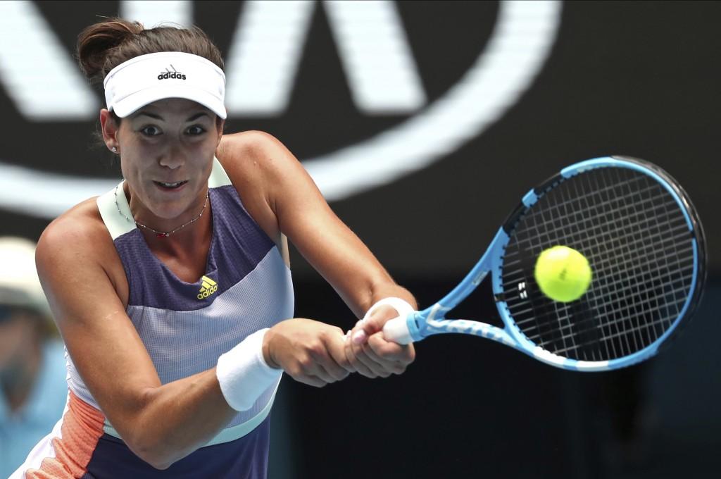 Spain's Garbine Muguruza makes a forehand return to Australia's Ajla Tomljanovic during their second round singles match at the Australian Open tennis...