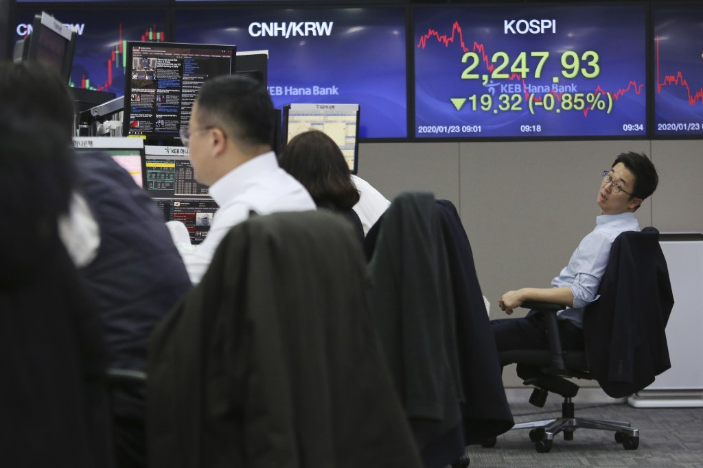A currency trader works at the foreign exchange dealing room of the KEB Hana Bank headquarters in Seoul, South Korea, Thursday, Jan. 23, 2020. Asian s...