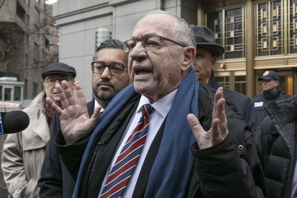 FILE - In this Dec. 2, 2019, file photo, attorney Alan Dershowitz talks to the press outside federal court, in New York. Retired law professor Alan De...