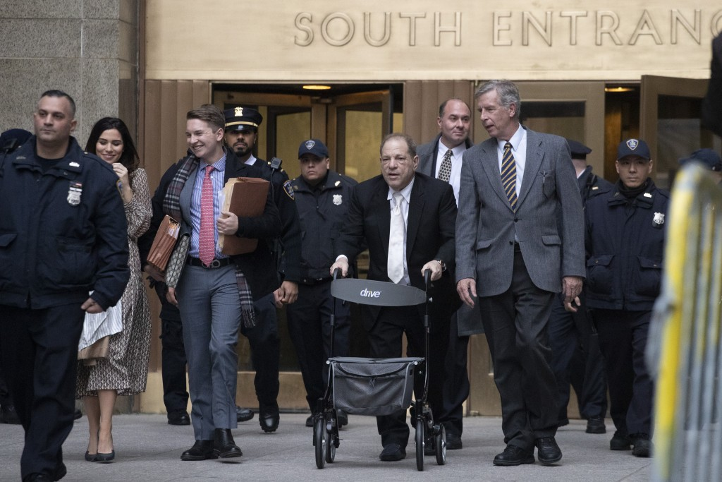 Harvey Weinstein uses a walker as he leaves a Manhattan courthouse after a day in his trial on rape and sexual assault charges, Thursday, Jan. 23, 202...