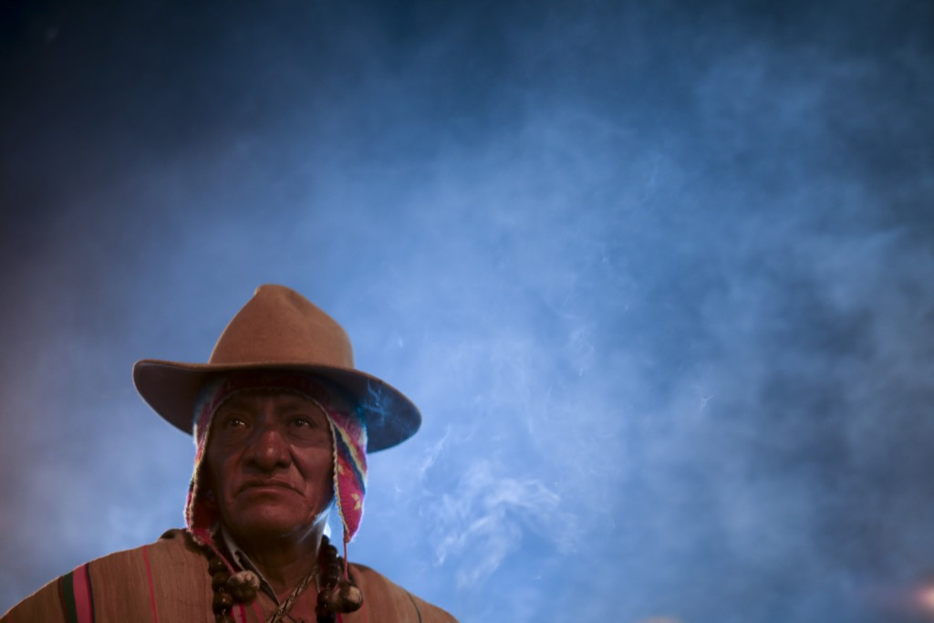 In this picture taken Monday, Jan. 6, 2020, spiritual indigenous guide Mariano Condori Flores stands outside San Francisco Church during the Three Kin...