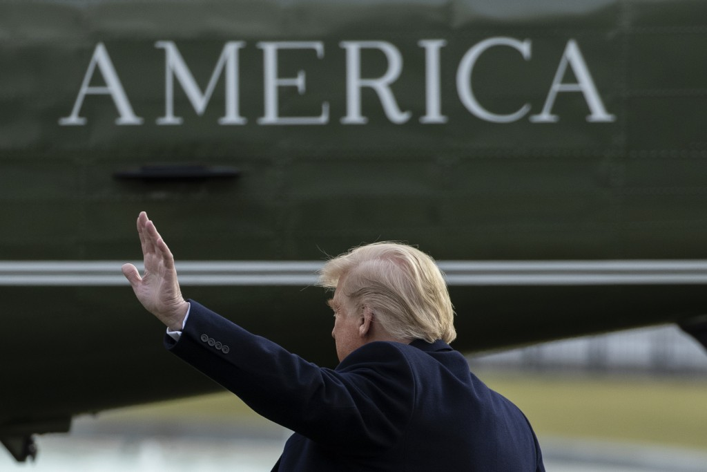 President Donald Trump waves as he walks on the South Lawn of the White House before departing on Marine One, Thursday, Jan. 23, 2020, in Washington, ...