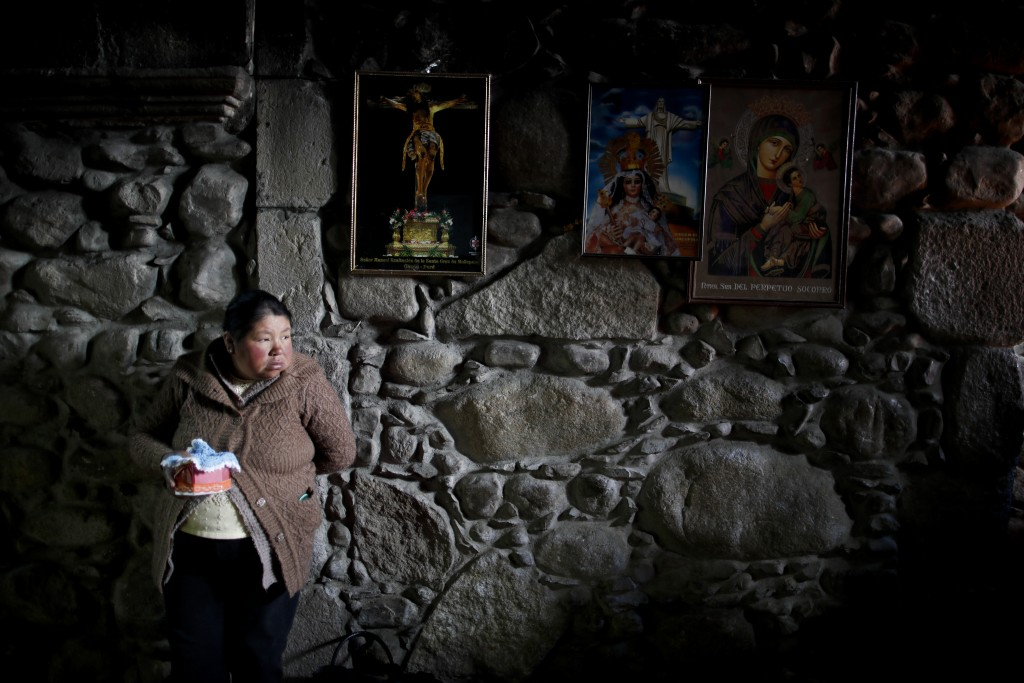 In this picture taken Jan. 6, 2020, a woman stands with her baby Jesus doll at San Francisco Church during the Three Kings Day celebrations in La Paz,...