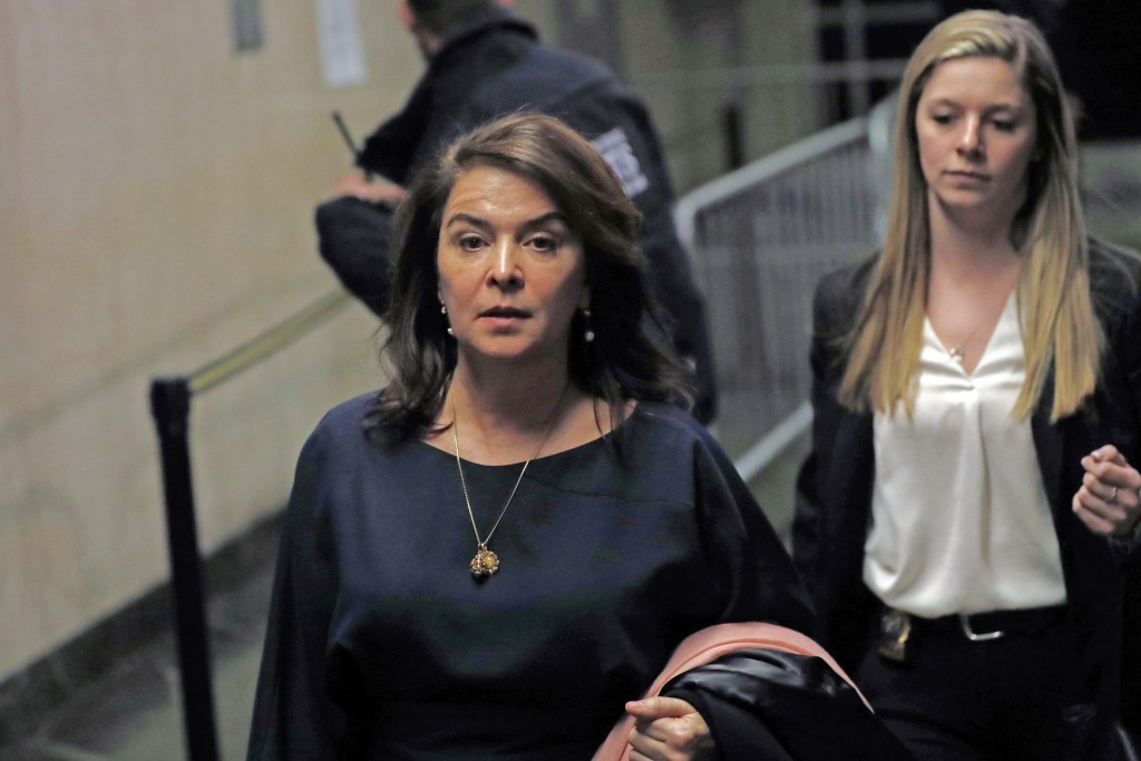 Actress Annabella Sciorra, left, leaves Manhattan Criminal Court after appearing at Harvey Weinstein's rape and sexual assault trial, Thursday, Jan. 2...