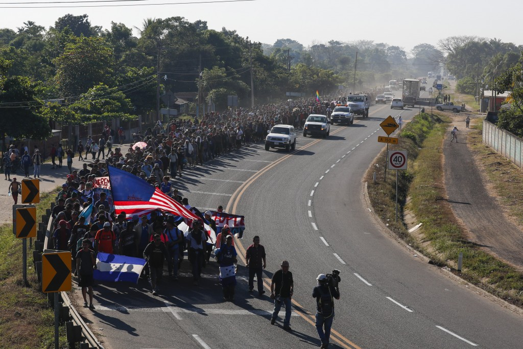 Central American migrants walk in Ciudad Hidalgo, Mexico, Thursday, Jan. 23, 2020. Hundreds of migrants hoping to reach the United States marooned in ...