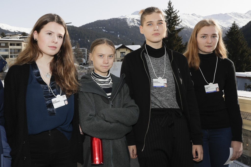 Climate activists Luisa Neubauer, Greta Thunberg, Isabelle Axelsson and Loukina Tille, from left, arrive for a news conference in Davos, Switzerland, ...