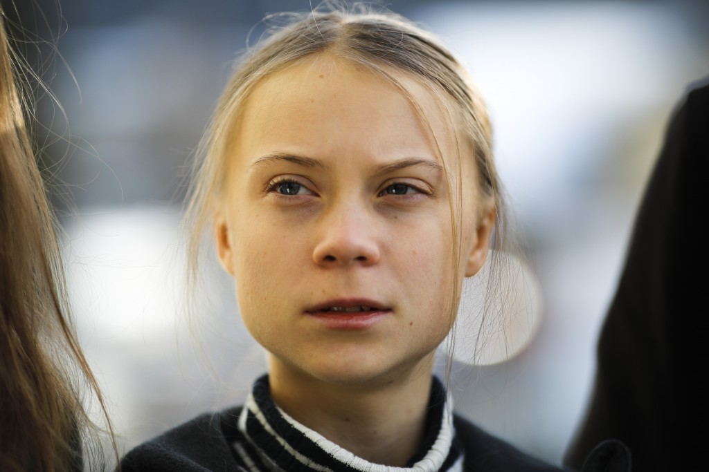Swedish climate activist Greta Thunberg poses for media as she arrives for a news conference in Davos, Switzerland, Friday, Jan. 24, 2020. The 50th an...