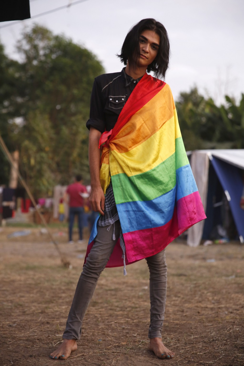 Honduran transgender migrant Esnny Argueta poses for a portrait at a temporary shelter set up by authorities for migrants arriving to Tecun Uman, Guat...