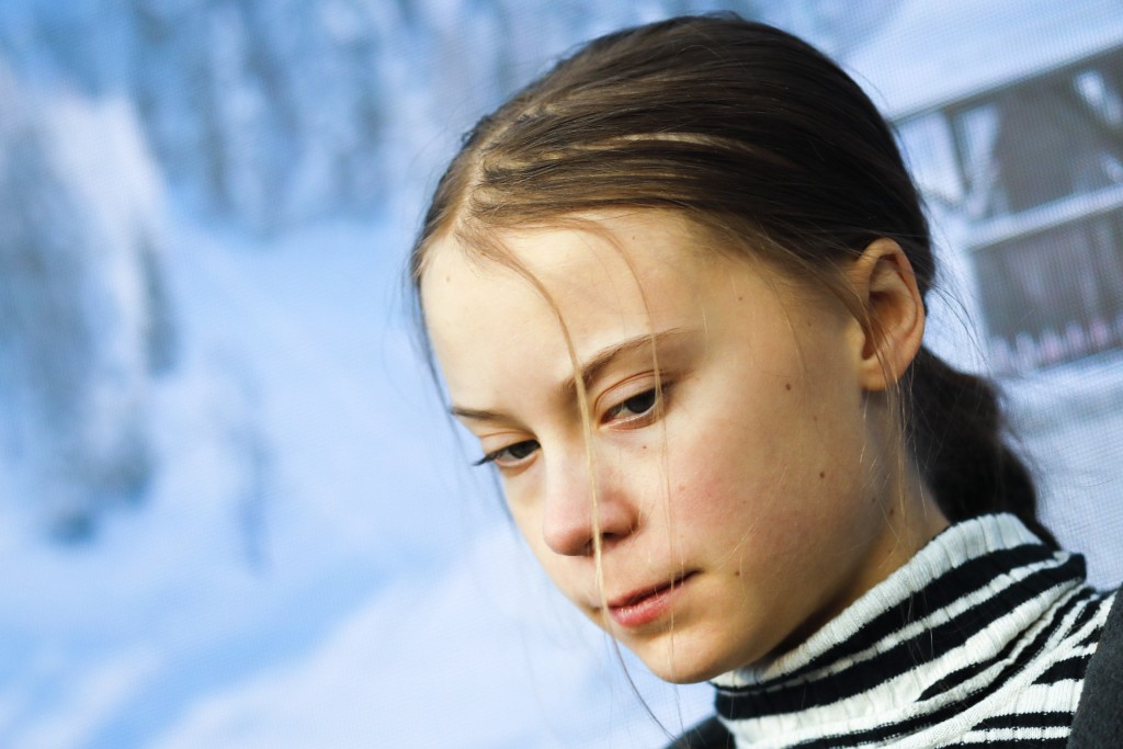 Swedish climate activist Greta Thunberg arrives for a news conference in Davos, Switzerland, Friday, Jan. 24, 2020. The 50th annual meeting of the for...