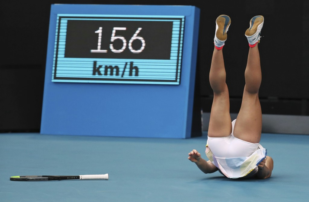 In this Tuesday, Jan. 21, 2020, file photo, Romania's Simona Halep falls during her first round match against Jennifer Brady of the U.S. at the Austra...