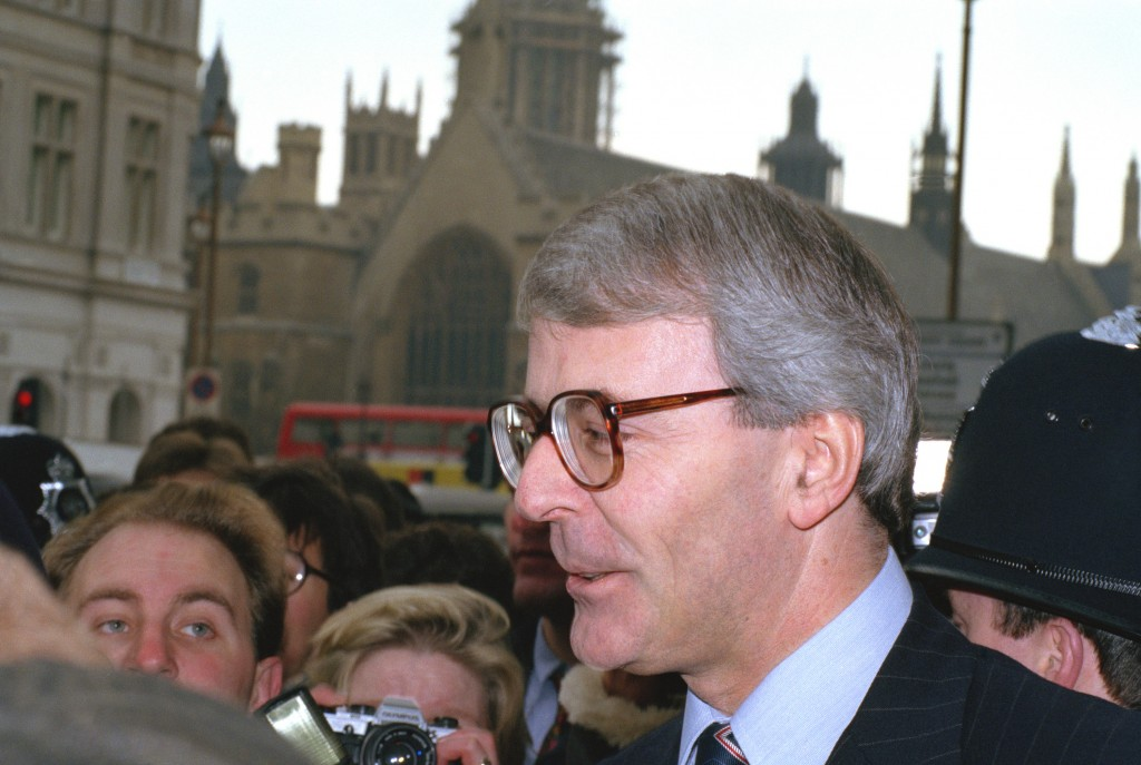 FILE - In this Thursday, Nov. 22, 1990, file photo, Britain's then Treasury chief John Major outside Parliament after he announced he would stand to r...