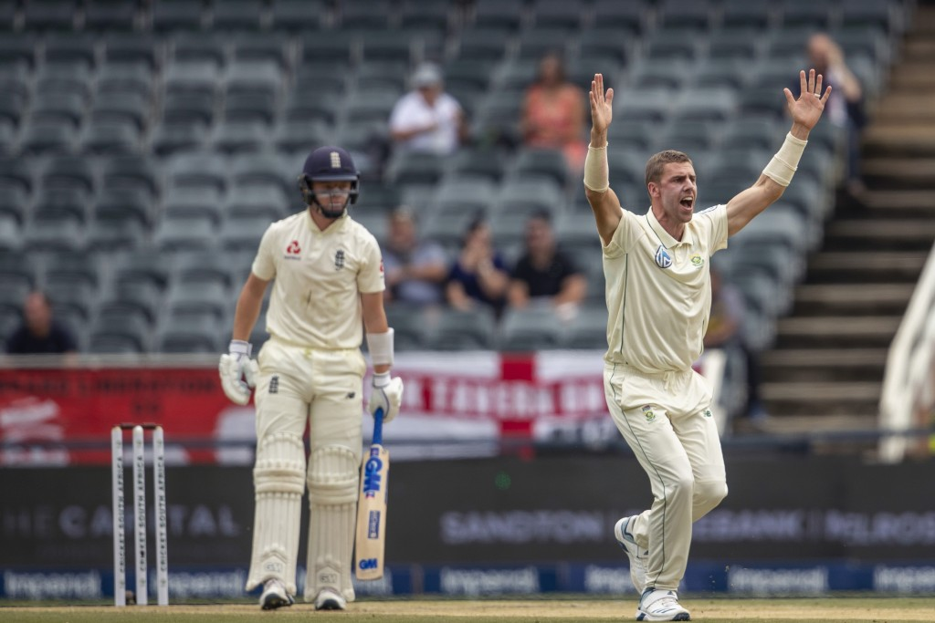 South Africa's bowler Anrich Nortje, right, appeals successfully for the wicket of England's batsman Ollie Popeon on day two of the fourth cricket tes...