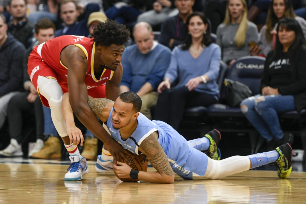 Minnesota Timberwolves guard Shabazz Napier, right, and Houston Rockets forward Danuel House Jr. battle for the ball during the first half of an NBA b...
