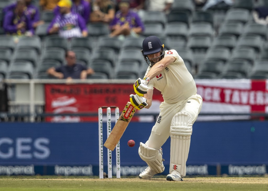 England's batsman Chris Woakes bats on day two of the fourth cricket test match between South Africa and England at the Wanderers stadium in Johannesb...