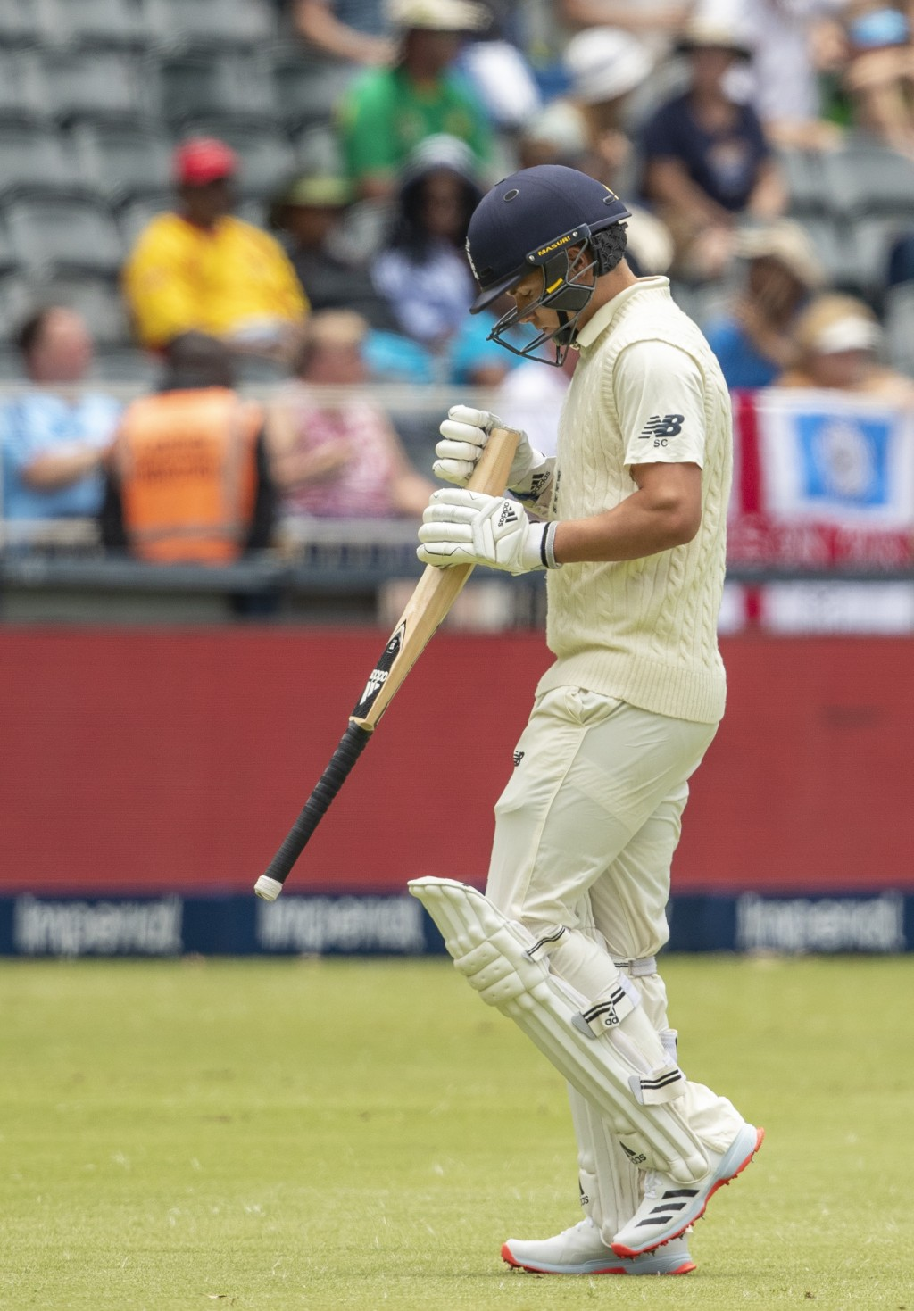 England's batsman Sam Curran leaves the field after being dismissed by South Africa's bowler Anrich Nortje for a duck, on day two of the fourth cricke...