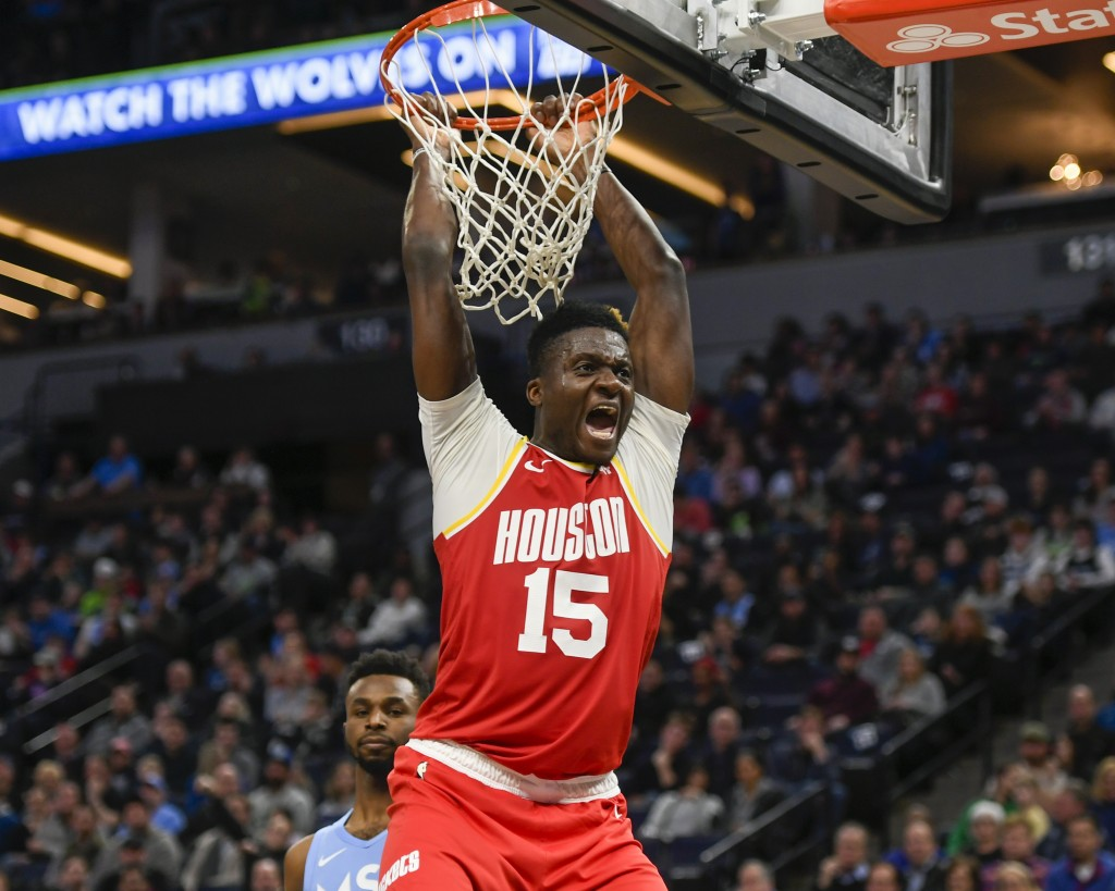 Houston Rockets center Clint Capela yells after dunking the ball against the Minnesota Timberwolves during the second half of an NBA basketball game F...