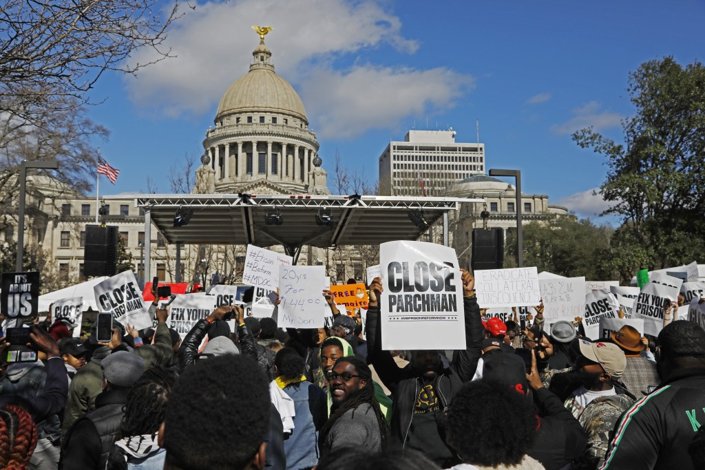 Several hundred people gather in front of the Mississippi Capitol in Jackson, on Friday, Jan. 24, 2020, to protest conditions in prisons where inmates...