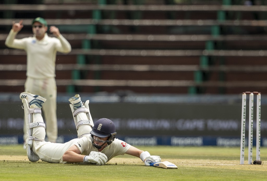 England's batsman Ollie Pope dives as he survives a run out on day two of the fourth cricket test match between South Africa and England at the Wander...