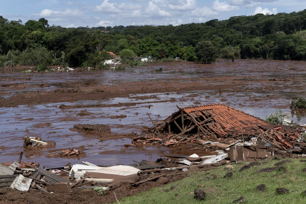 FILE - In this  Jan. 25, 2019 file photo, a structure lays in ruins after a dam collapsed near Brumadinho, Brazil. The wave of mud and debris that on ...