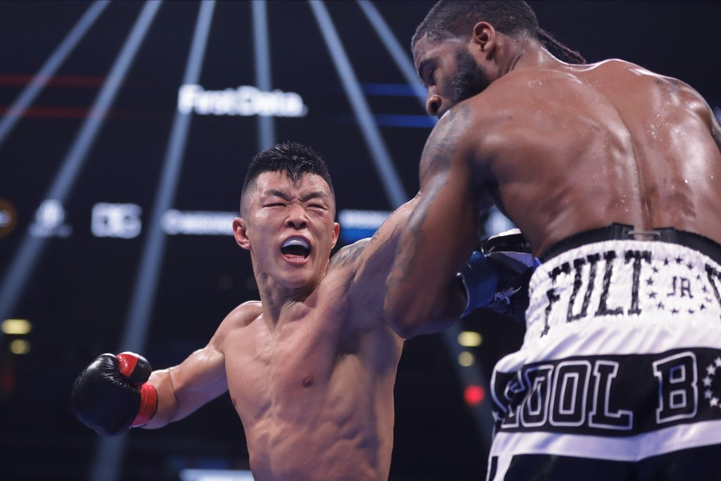 Ukraine's Arnold Khegai, left, punches Stephen Fulton during the 11th round of a WBO Intercontinental Jr. featherweight championship boxing match Satu...