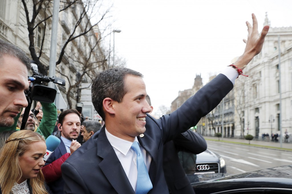 The leader of Venezuela's political opposition Juan Guaido waves during a visit to Madrid, Spain, Saturday, Jan. 25, 2020. Juan Guaido, the man who on...
