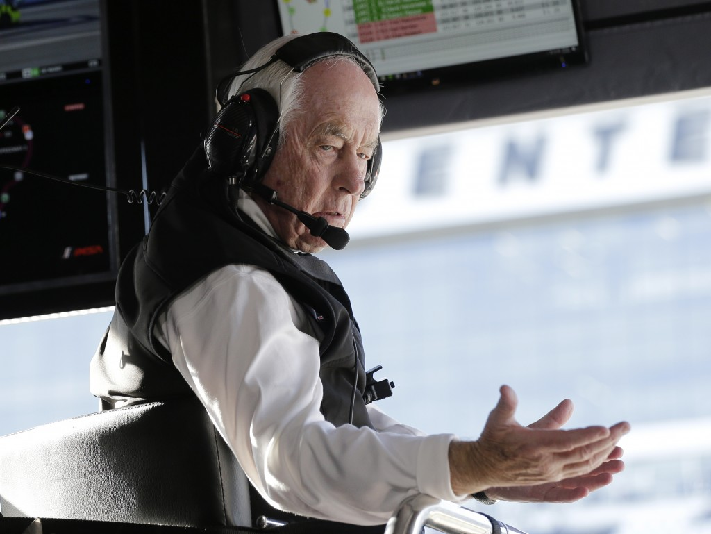 Acura Team Penske owner Roger Penske gestures to a crew member during the Rolex 24 hour auto race at Daytona International Speedway, Saturday, Jan. 25...