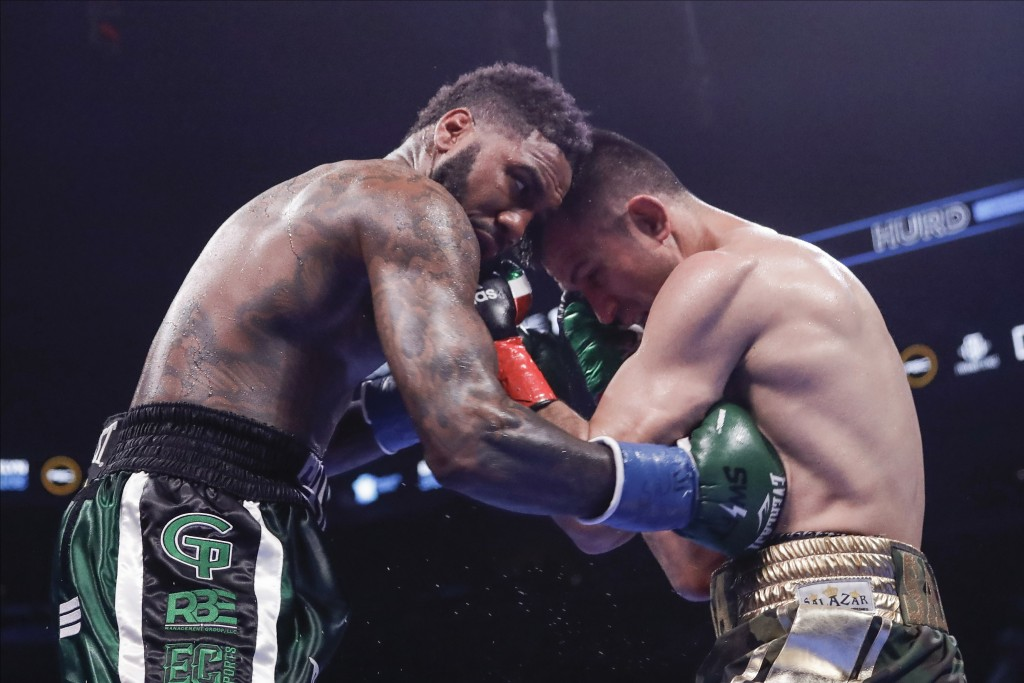 Jarret Hurd, left, lands a body shot on Francisco Santana during the seventh round of a super welterweight boxing match Saturday, Jan. 25, 2020, in Ne...