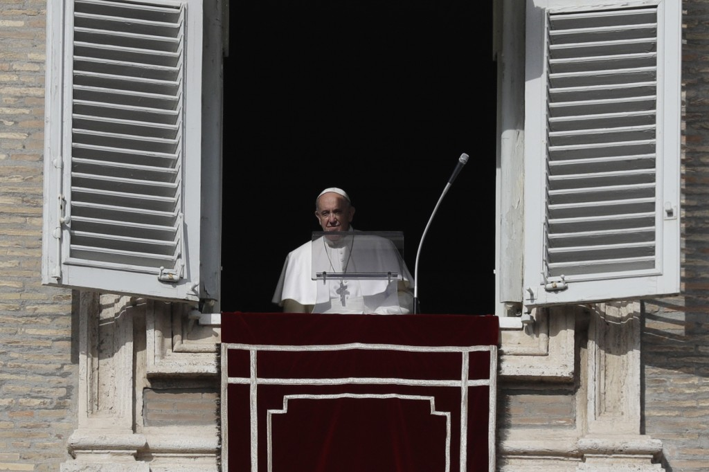 Pope Francis approaches his studio window overlooking St. Peter's Square to deliver the Angelus noon prayer at the Vatican, Sunday, Jan. 26, 2020. (AP...