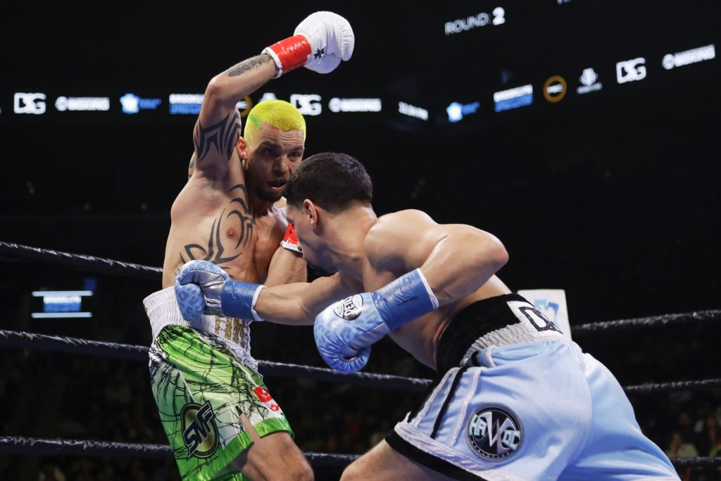 Ukraine's Ivan Redkach, left, evades Danny Garcia during the second round of a welterweight boxing match Saturday, Jan. 25, 2020, in New York. Fulton ...