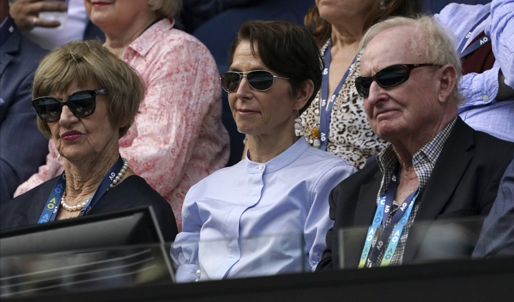 Former Australian Open champions, Margaret Court, left, and Rod Laver, right, watch the fourth round singles match between Serbia's Novak Djokovic and...