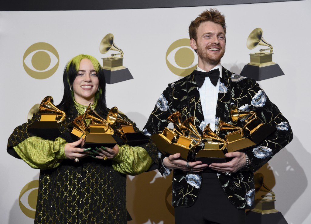 """Billie Eilish, left, and Finneas O'Connell pose in the press room with the awards for best album, best engineered album and best pop vocal album for """"..."""