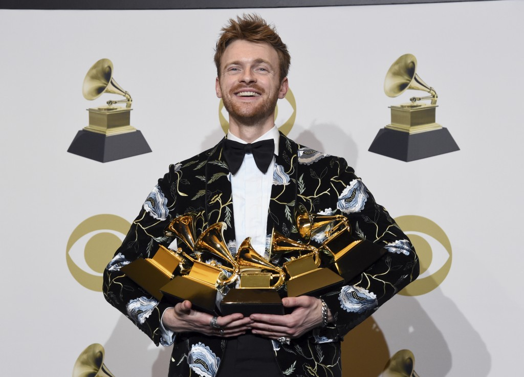 """Finneas O'Connell poses in the press room with the awards for best song and best record for """"Bad Guy,"""" album of the year and best engineered album, no..."""