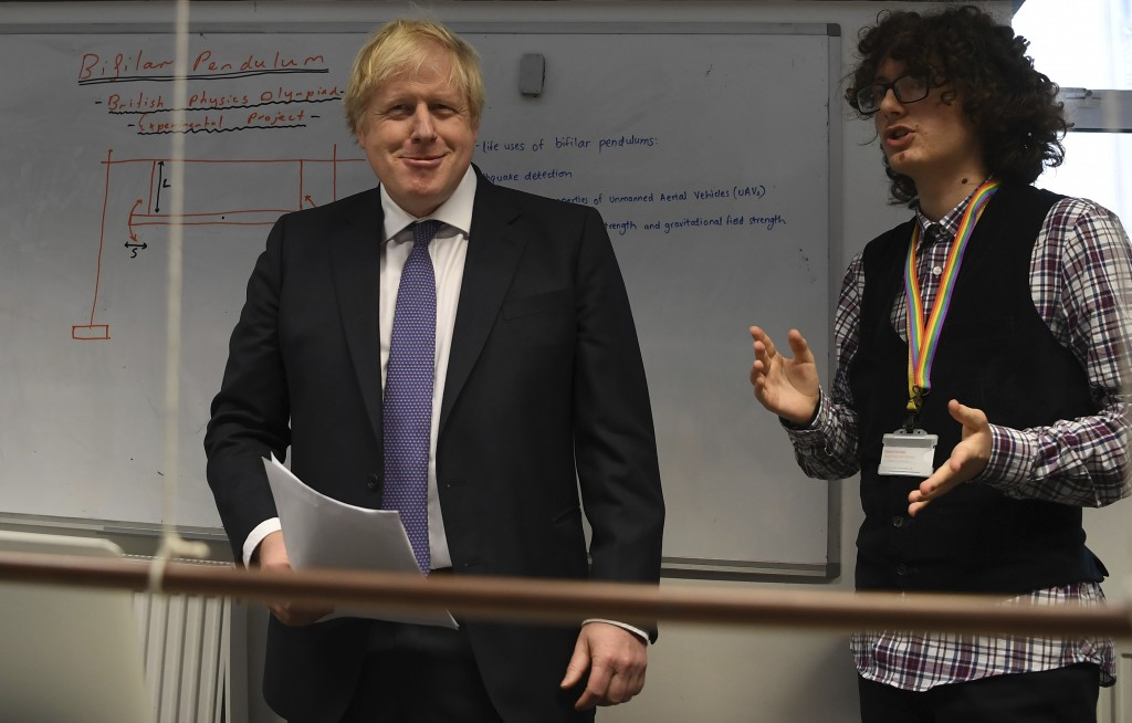 Britain's Prime Minister Boris Johnson, center, visits the Department of Mathematics at King's Maths School, part of King's College London University,...
