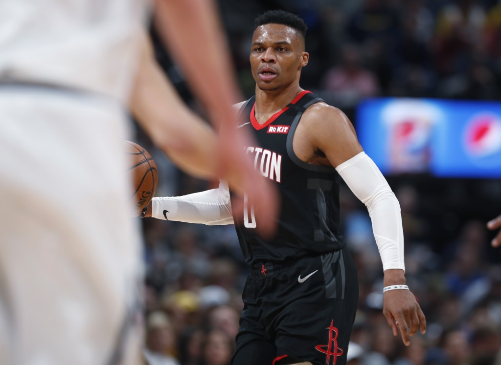 Houston Rockets guard Russell Westbrook looks to pass the ball against the Denver Nuggets in the first half of an NBA basketball game Sunday, Jan. 26,...