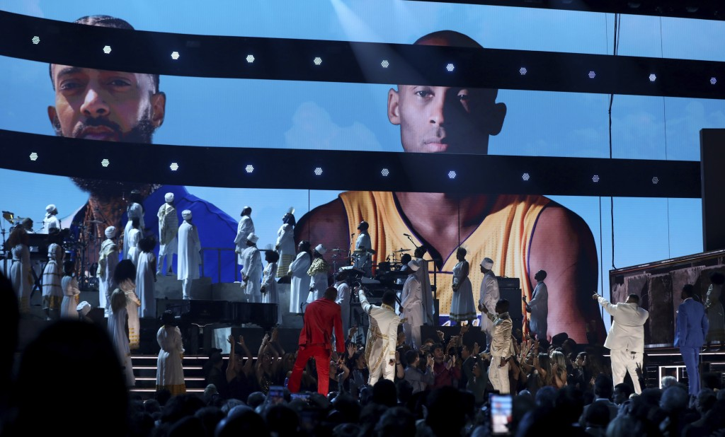 YG, from left, John Legend, Kirk Franklin, DJ Khaled and Meek Mill point to a screen showing Nipsey Hussle and Kobe Bryant during a tribute at the 62n...