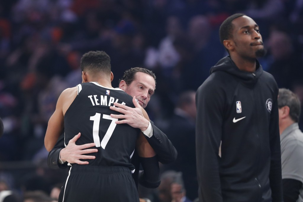 Brooklyn Nets head coach Kenny Atkinson embraces Brooklyn Nets guard Garrett Temple (17) following a moment of silence for retired Los Angeles Lakers ...