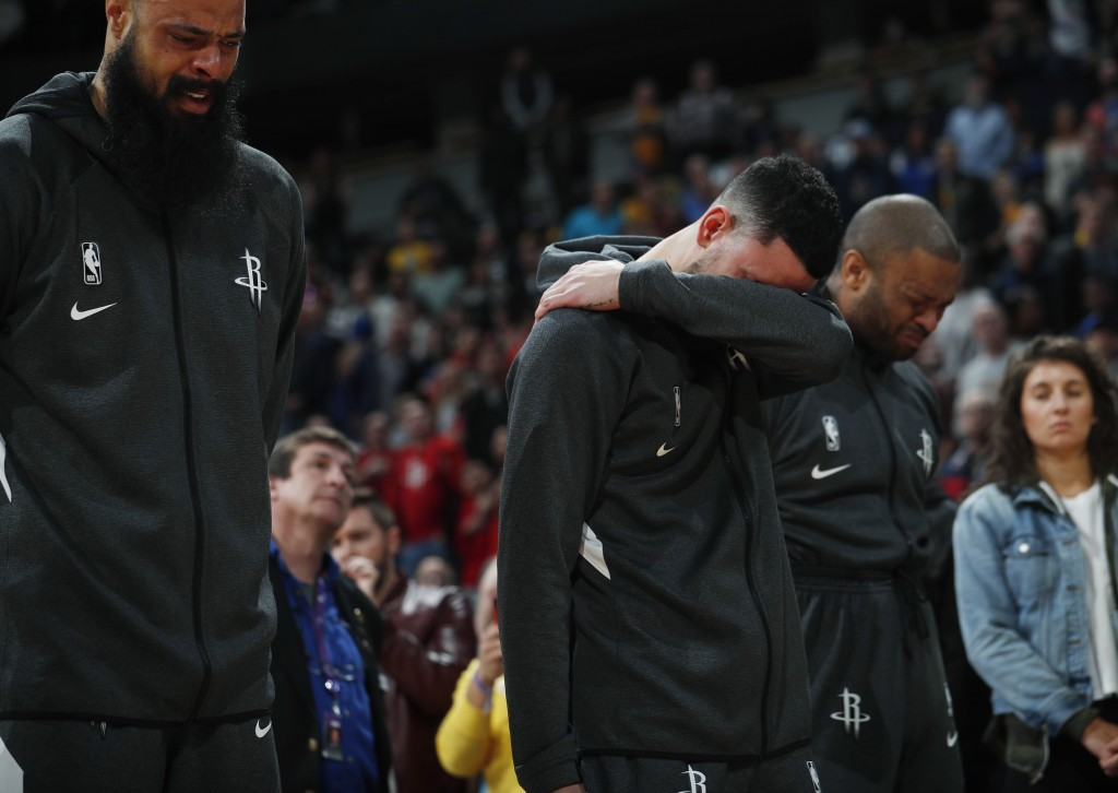 From left to right, Houston Rockets center Tyson Chandler, guard Austin Rivers and forward P.J. Tucker react during a tribute to Kobe Bryant before an...