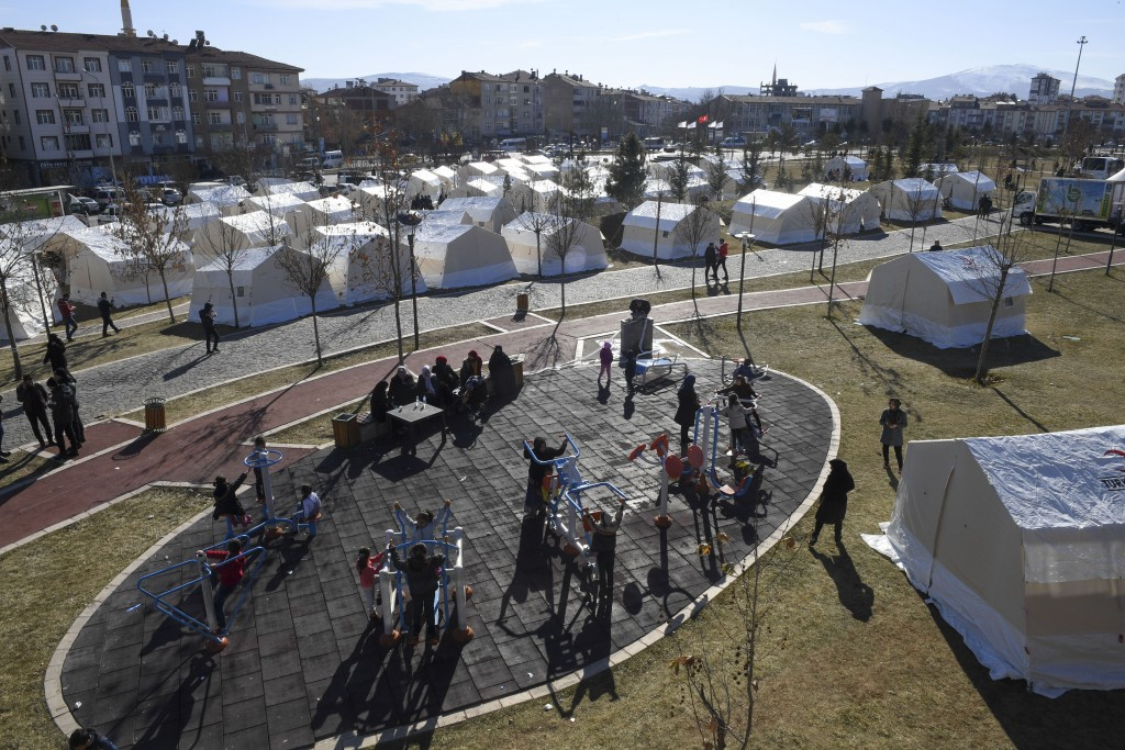 Tents setup by the government for survivors following a strong earthquake that destroyed several buildings on Friday, in Elazig, eastern Turkey, Sunda...