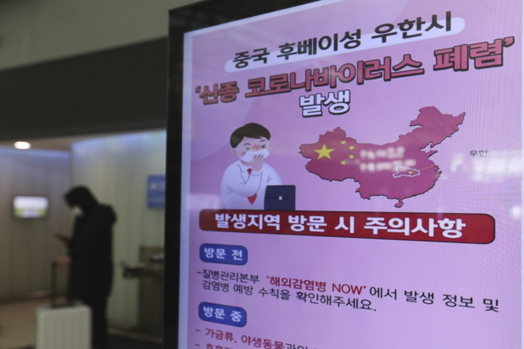 A poster warning about coronavirus is displayed in a departure lobby at Incheon International Airport in Incheon, South Korea, Monday, Jan. 27, 2020. ...