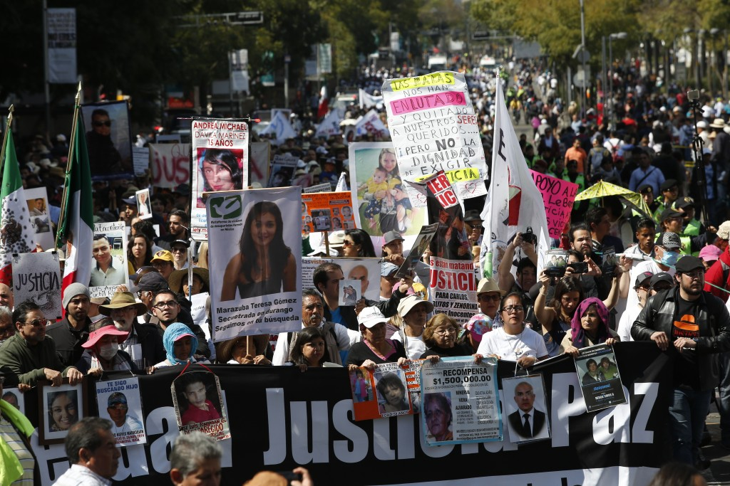 """People walk with members of the LeBaron family and activist and poet Javier Sicilia during a march against violence called """"Walk for Peace,"""" in Mexico..."""