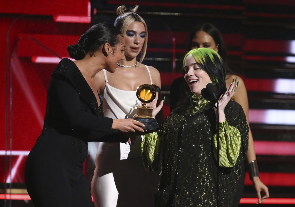 Alicia Keys, from left, and Dua Lipa present Billie Eilish with the award for best new artist at the 62nd annual Grammy Awards on Sunday, Jan. 26, 202...